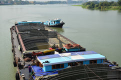 Barge and Tug Boat cargo ship in Choaphraya river at Ayutthaya Thailand Stock Photo
