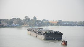 Barge and Tug Boat cargo ship in Choaphraya river at Ayutthaya Thailand. A barge is a flat-bottomed boat, built mainly for river and canal transport of heavy stock video