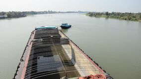 Barge and Tug Boat cargo ship in Choaphraya river at Ayutthaya Thailand. A barge is a flat-bottomed boat, built mainly for river and canal transport of heavy stock video footage