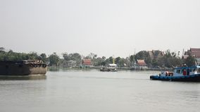Barge and Tug Boat cargo ship in Choaphraya river at Ayutthaya Thailand. A barge is a flat-bottomed boat, built mainly for river and canal transport of heavy stock footage