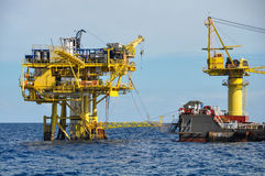 Barge and tug boat in open sea,Oil and gas platform in the gulf or the sea, The world energy, Offshore oil and rig construction.  stock photography