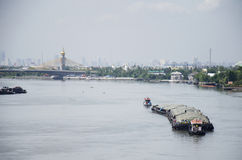 Barge and Tugboat cargo ship in Chao Phraya river Royalty Free Stock Photography