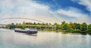 Barge under the Hoger Brug Higher Bridge on the River Maas. Maastricht, Limburg, The Netherlands, Europe royalty free stock image