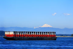 Barge under mountain Royalty Free Stock Photos