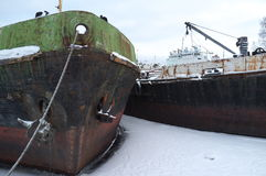 Barge winter in the ice. Winter Parking old barges in Petrozavodsk, lake Onega Royalty Free Stock Images