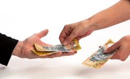 Bargeld in der Hand Stockfoto