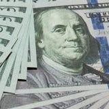 Bargeld 100 Dollar Hintergrund Stockfotografie