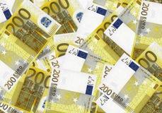 Bargeld-Hintergrundgeld des Euros 200 Feder, Brillen und Diagramme Konzepterfolgsreichwirtschaft Lizenzfreie Stockfotografie