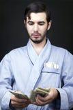 Bargeld zu Hause machen Stockfotografie