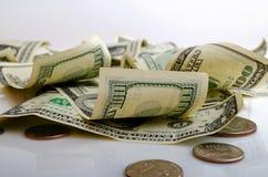 Bargelddollar und Cents US Stockbilder