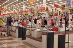 Bargeldzone im Supermarkt Stockbilder