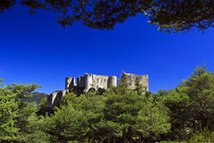 Bargeme Castle rising above the thickly forested Var Stock Photography