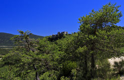 Bargeme Castle rising above the thickly forested Var Stock Image