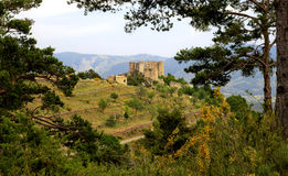 Bargeme and its Castle with Yellow Broom Royalty Free Stock Images