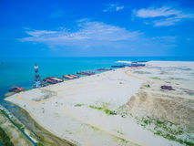 Barges berthed on the beach. Aerial view. Barges berthed on the beach. construction Stock Image