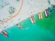 Barges berthed on the beach. Aerial view. Barges berthed on the beach. Construction Royalty Free Stock Image