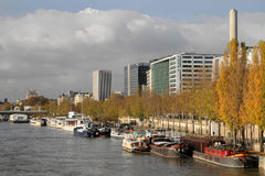 Barges and buildings on Seine river in Paris Royalty Free Stock Image