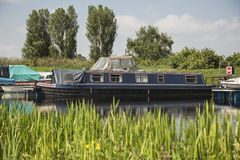 Barges on a canal. Barges moored on a canal with colourful surroundings Stock Image