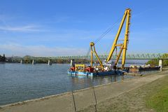 Barges with construction equipment. Barge with huge construction crane royalty free stock image