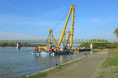 Barges with construction equipment. Barge with huge construction crane stock photos