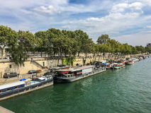Barges and houseboats along the Right Bank of the Seine River, Paris France Royalty Free Stock Photos