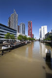 Barges and modern buildings in Rotterdam Stock Photos
