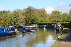 Barges or narrow boats moored on a canal. Royalty Free Stock Images
