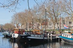 Barges in old historic harbor of The Netherlands Royalty Free Stock Photo