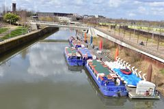 Canal in the London  Olympic park. Barges and swan boats on the Olympic park canal that surrounds the Olympic stadium in London Royalty Free Stock Image