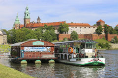 Barges on Wisla river near Wawel Royal Castle in Krakow, Poland. Royalty Free Stock Photography
