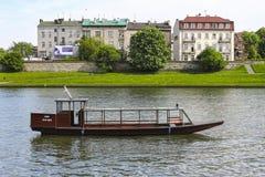 Barges on Wisla river near Wawel Royal Castle in Krakow, Poland. Stock Photos