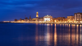 Bari night cityscape and  seafront. city lights at evening Stock Photos