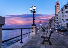 Bari seafront. Colorful amazing sunset. Coastline and city view. stock photography