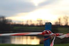 Bariera przed wodą - wschód słońca w jesieni Fotografia Royalty Free