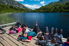 Hikers relax near the lake stock photos