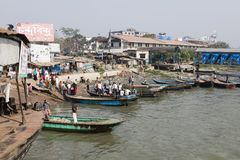 Barisal, Bangladesh, February 27 2017: Small wooden boats serving as water taxi. S await customers in the port of Barisal stock photos