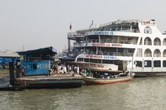 Barisal, Bangladesh, February 27 2017: Small wooden boats, serving as water taxi. S, unload passengers at the port of Barisal royalty free stock photography
