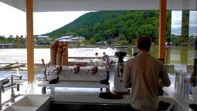 Barista At Arashiyama River fotografie stock