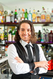 Barista or barman behind his bar Royalty Free Stock Image