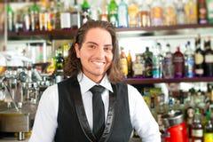 Barista or barman behind his bar Stock Photography