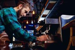 Barista bartender barman makes coffee in the bar cafe stock photo