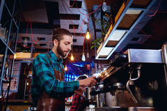Barista bartender barman makes coffee in the bar cafe stock images