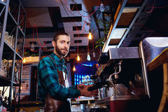 Barista bartender barman makes coffee in the bar cafe stock photography