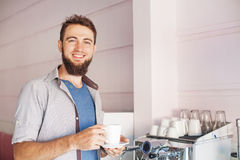 Barista with beard making coffee in a cafe Stock Photo