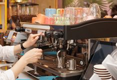 Barista is brewing coffee Stock Image
