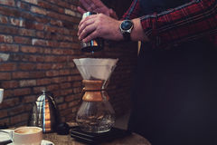 Barista brewing coffee Stock Photography