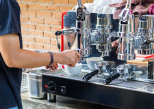 Barista brewing hot coffee with coffee machine Royalty Free Stock Photo