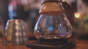 Barista brews coffee in Coffee maker Chemeks stock video