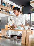 Barista brews a single cup a coffee house Stock Photography