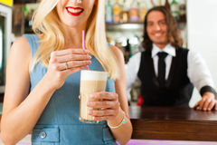 Barista with client in his cafe or coffeeshop Stock Photos